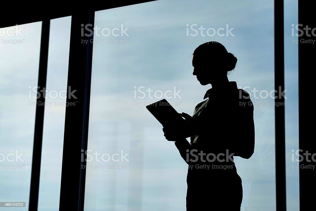 Silhouette with tablet stock photo