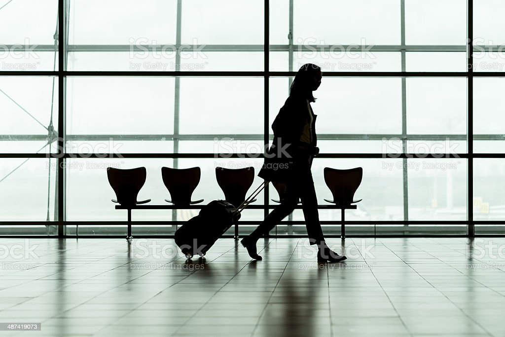 Silhouette woman traveller in airport royalty-free stock photo