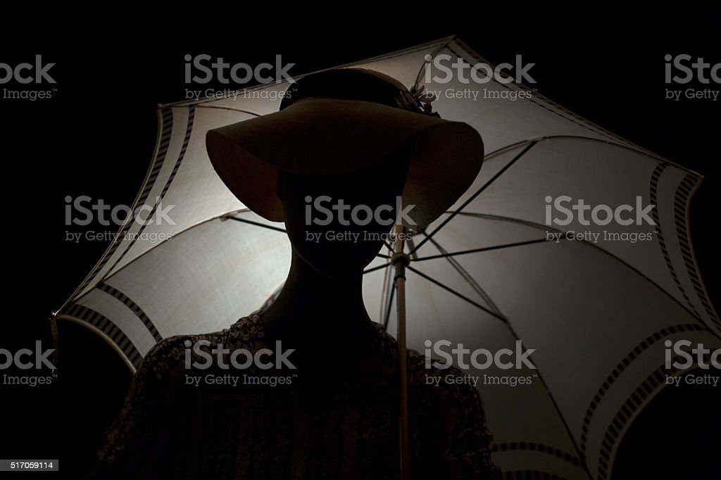 Silhouette woman with an umbrella. stock photo