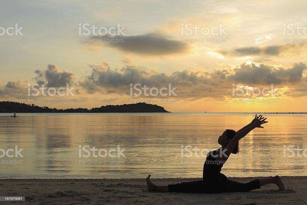 Silhouette  yoga girl at sunrise on the beach,,,Hanumanasana stock photo