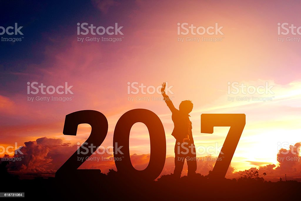 Silhouette young man Happy for 2017 new year stock photo