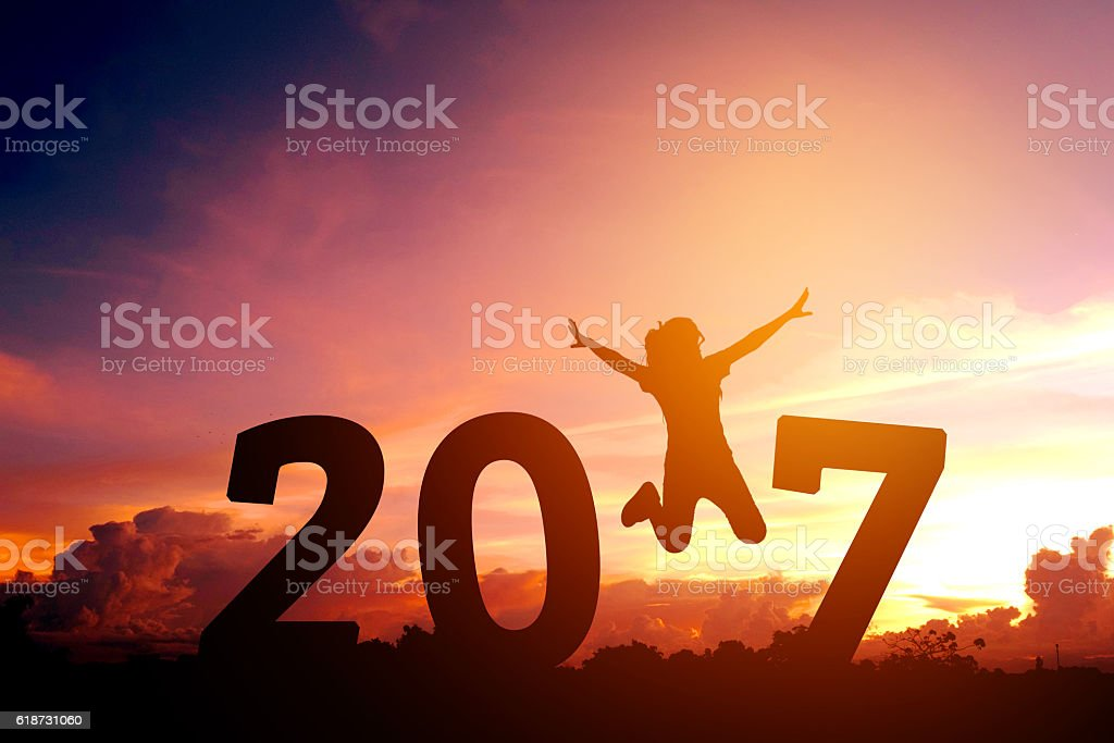 Silhouette young woman jumping to 2017  new year stock photo