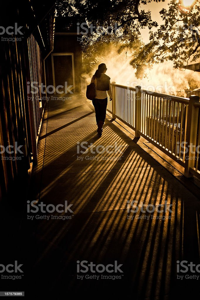 silhouette young woman walking in a balcony stock photo