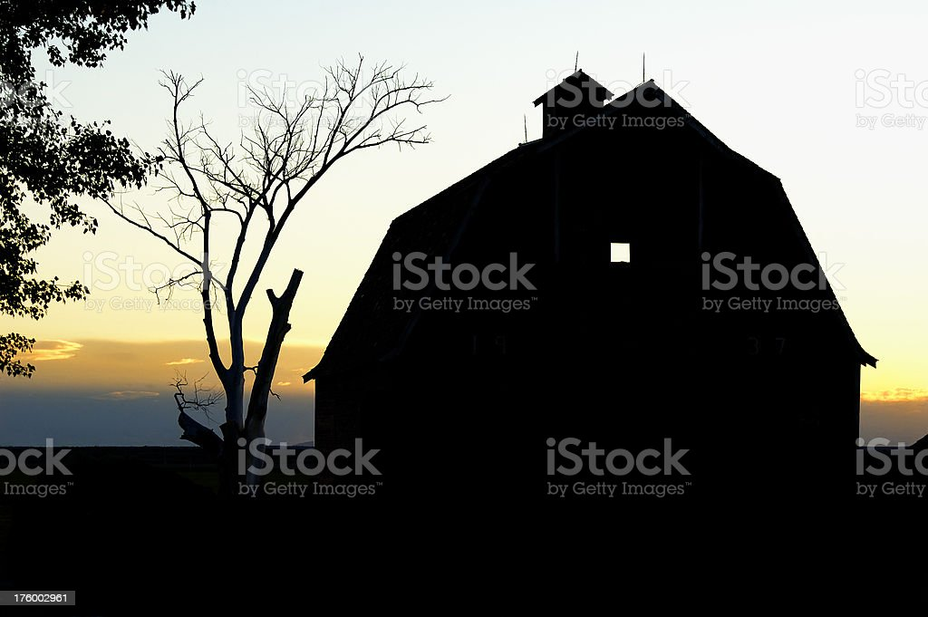Silhouetted Barn In Sunset stock photo