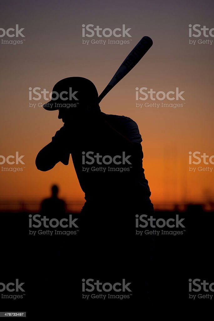 Silhouetted Baseball Batter at Sunset royalty-free stock photo