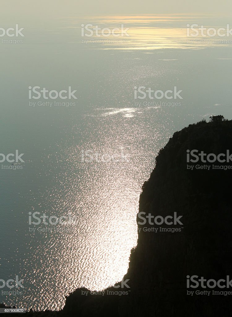 Silhouetted Bluff Along Mediterranean Sea stock photo
