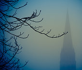 Silhouetted Church And Tree