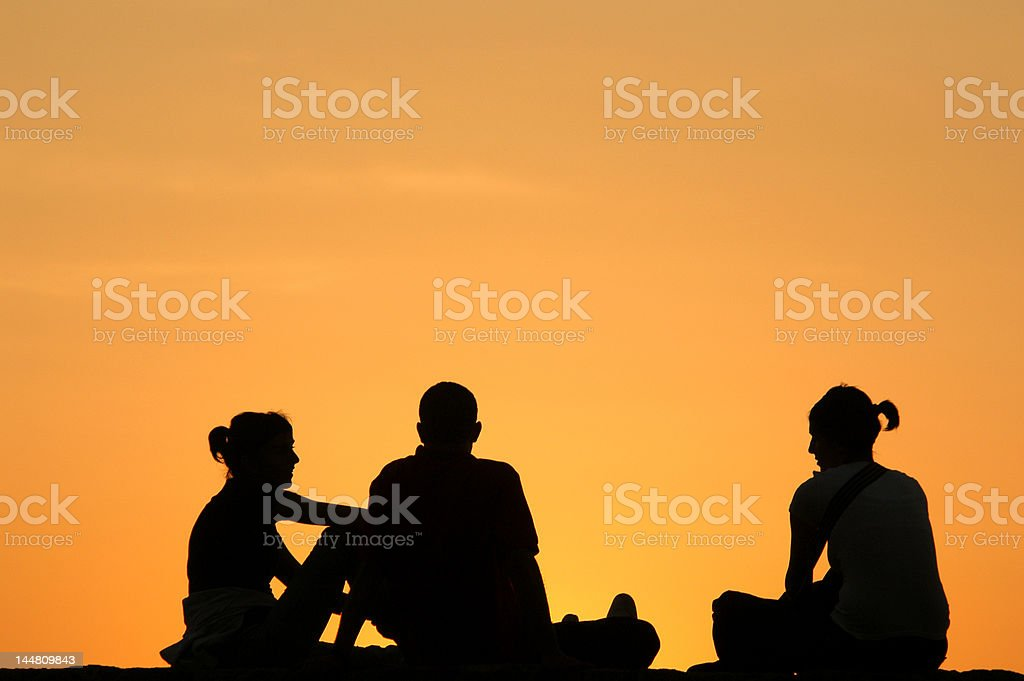 Silhouetted Company at Sunset royalty-free stock photo