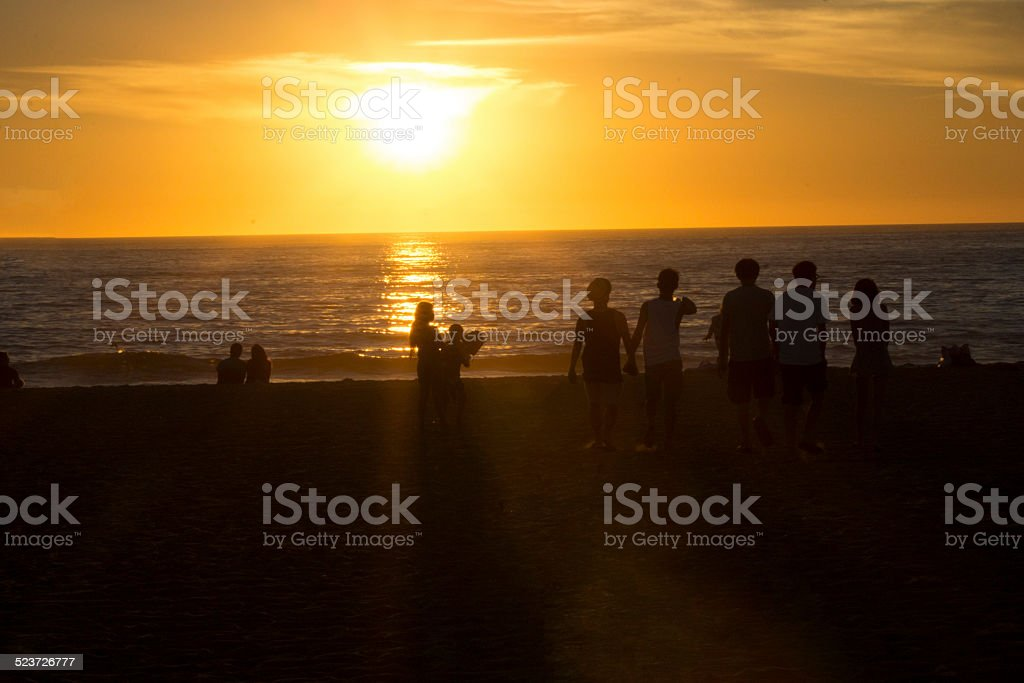 Silhouetted Crowd watching Sunset stock photo