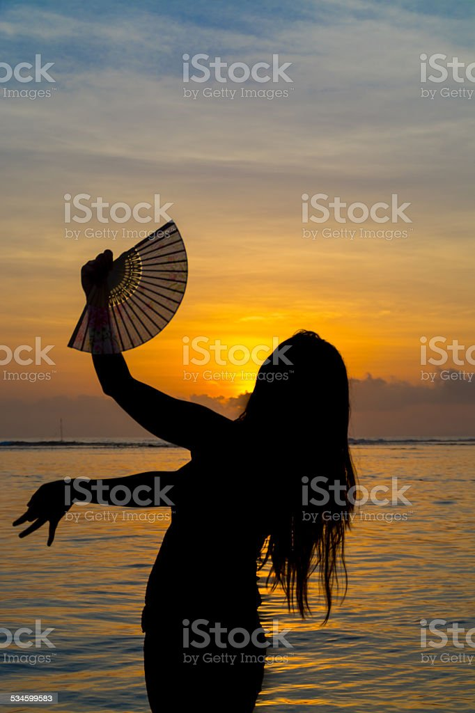 Silhouetted dancer at sunsset stock photo