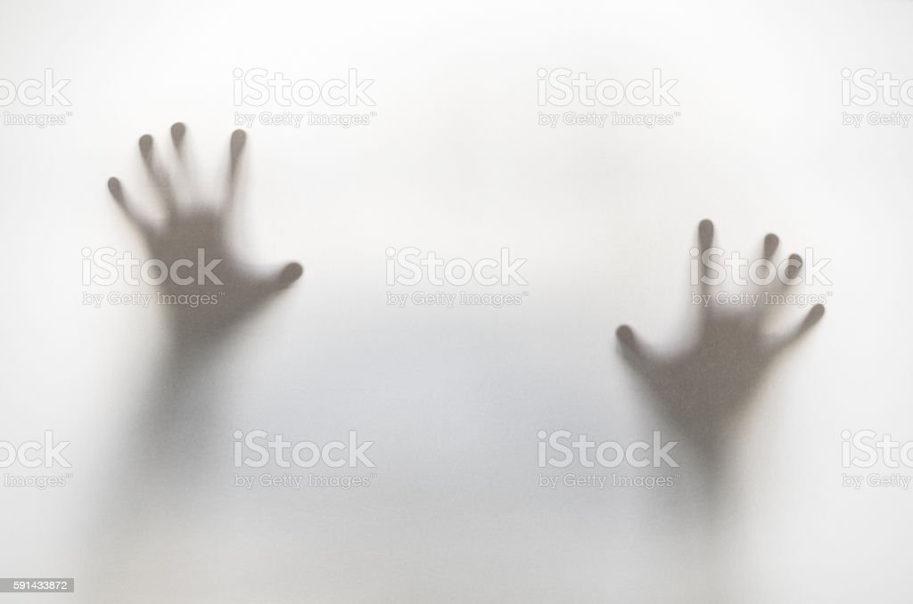 Silhouetted hands stock photo