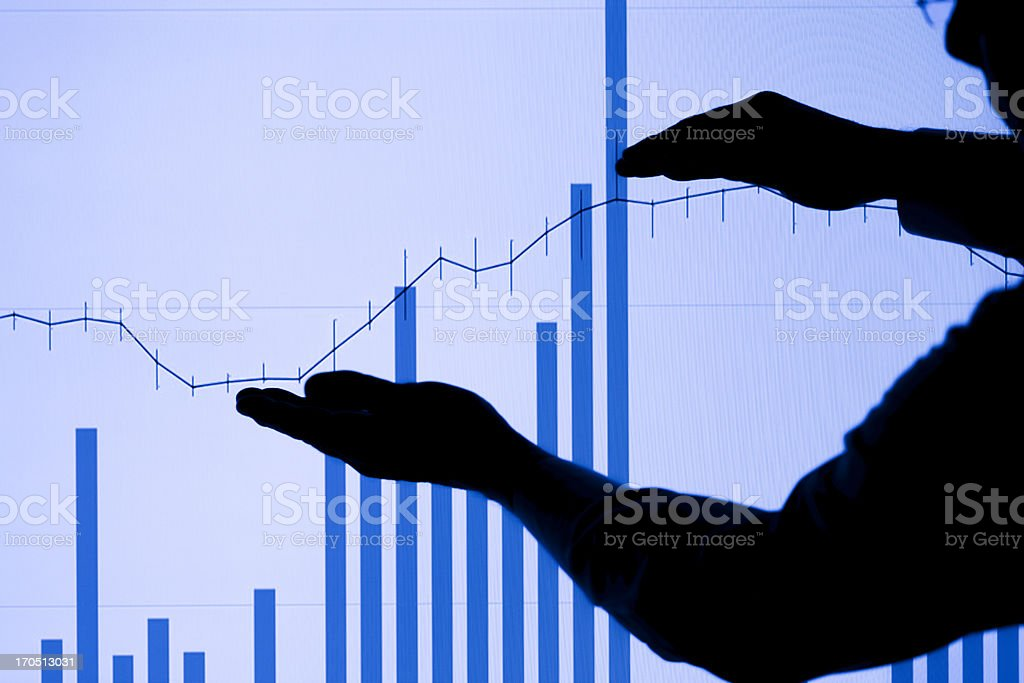 Silhouetted Man and Rising Chart royalty-free stock photo