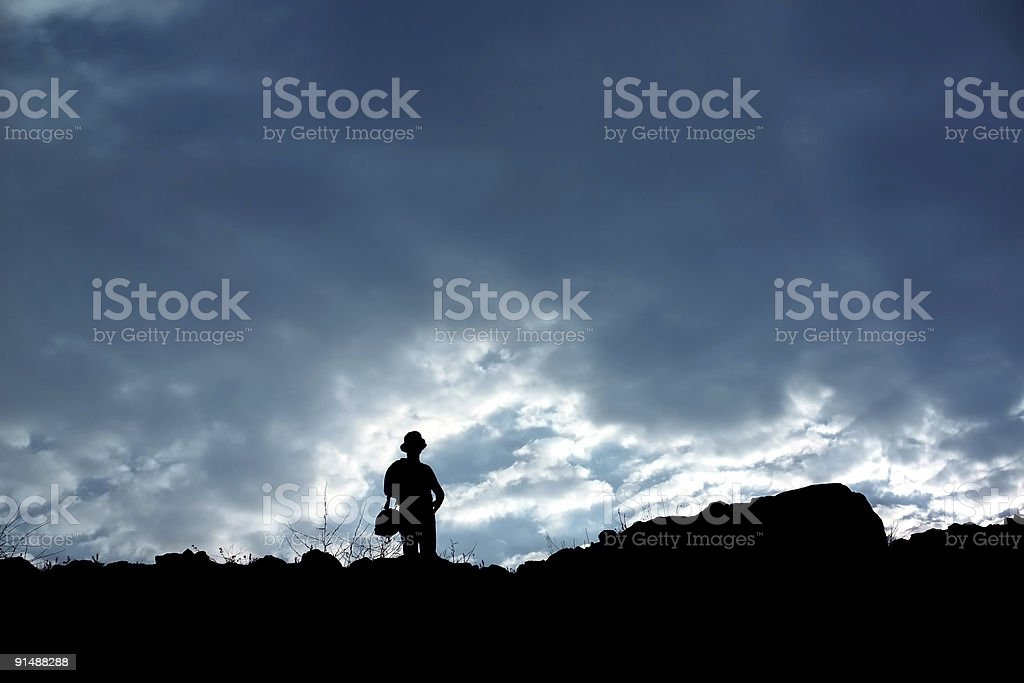 Silhouetted man exploring royalty-free stock photo