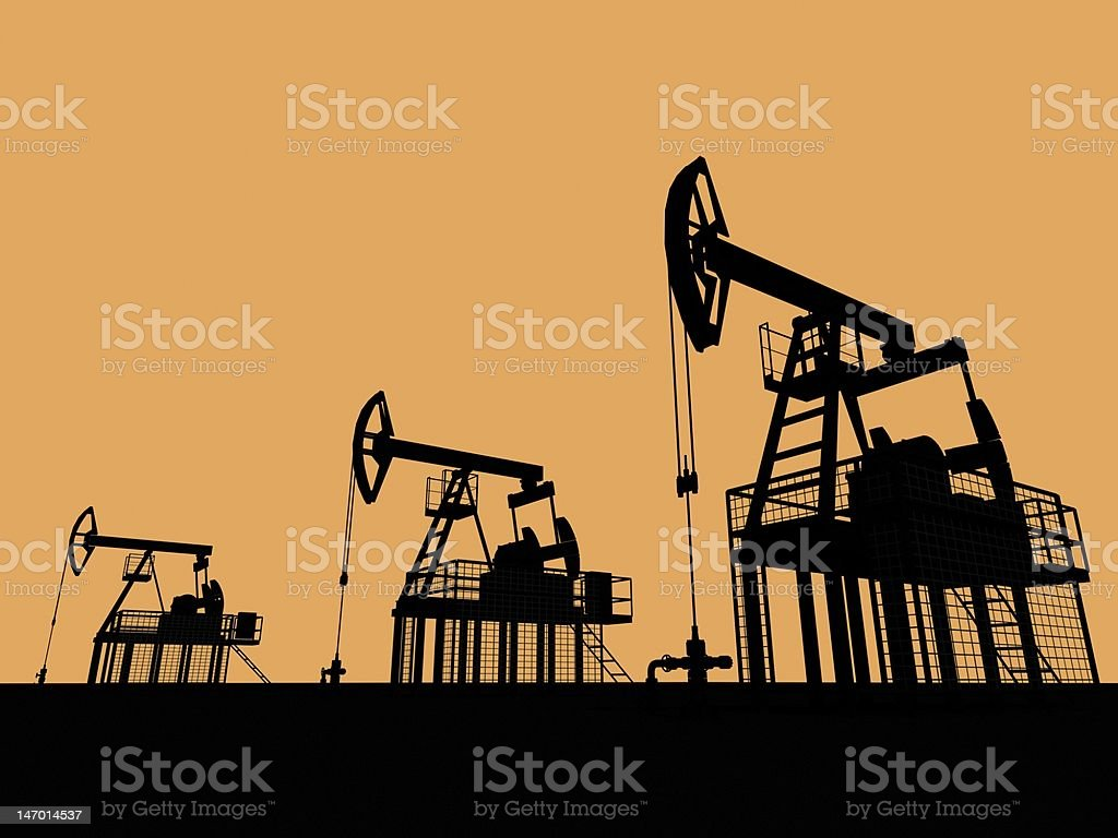 Silhouetted oil wells royalty-free stock photo
