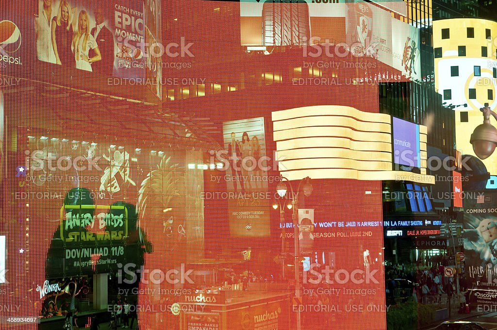 Silhouetted romantic couple in front of Times Square lights royalty-free stock photo