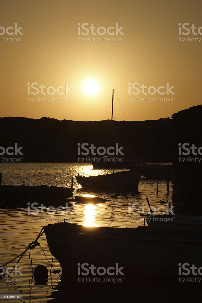 Silhouetted ships stock photo
