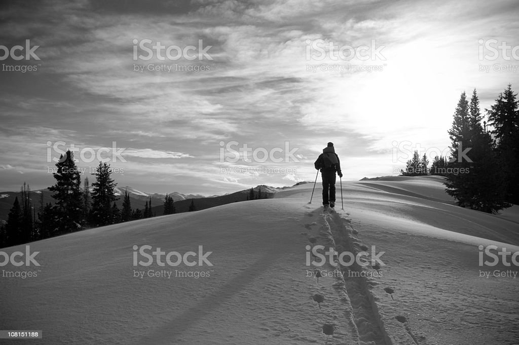 Silhouetted Solo Male Skier in Colorado Backcountry royalty-free stock photo