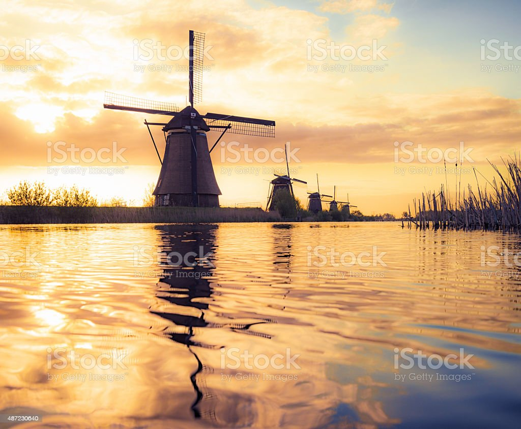 Silhouetted traditional windmills in Holland stock photo