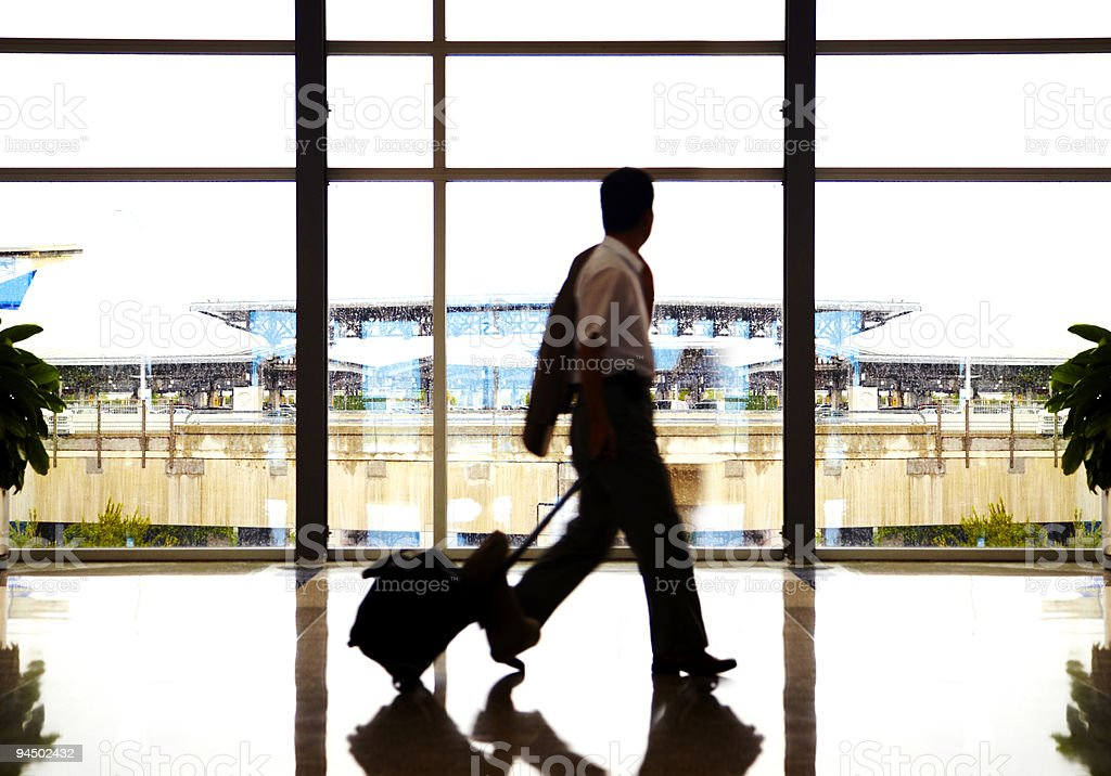 Silhouetted travel walking at airport stock photo