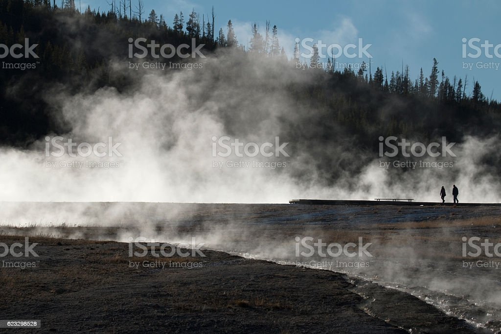 Silhouetted visitors steaming Midway Geyser Basin Yellowstone National Park Wyoming stock photo