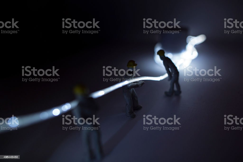 Silhouetted work men installation stock photo