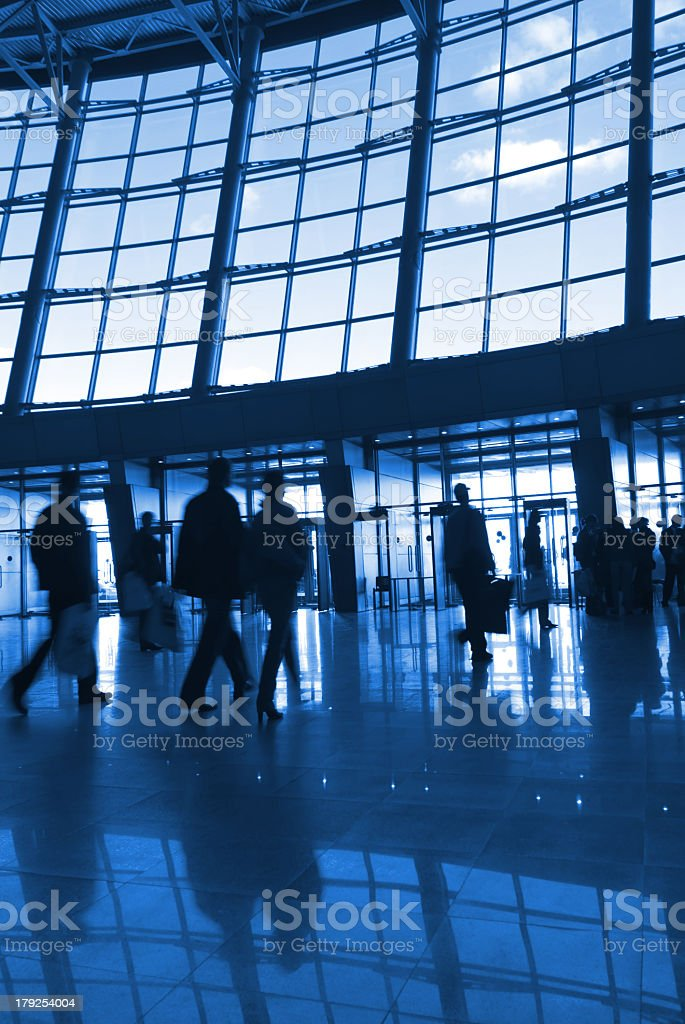 Silhouettes and reflections of people in an airport building royalty-free stock photo