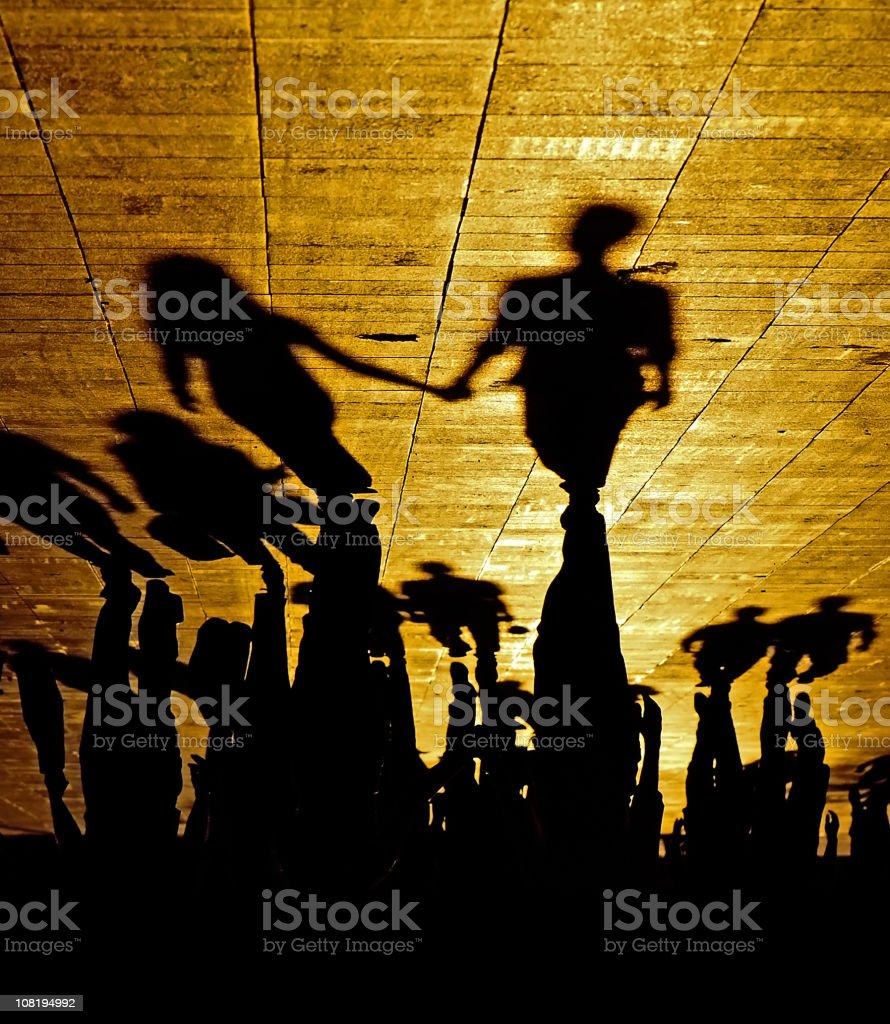 Silhouettes and Shadows of People Holding Hands royalty-free stock photo