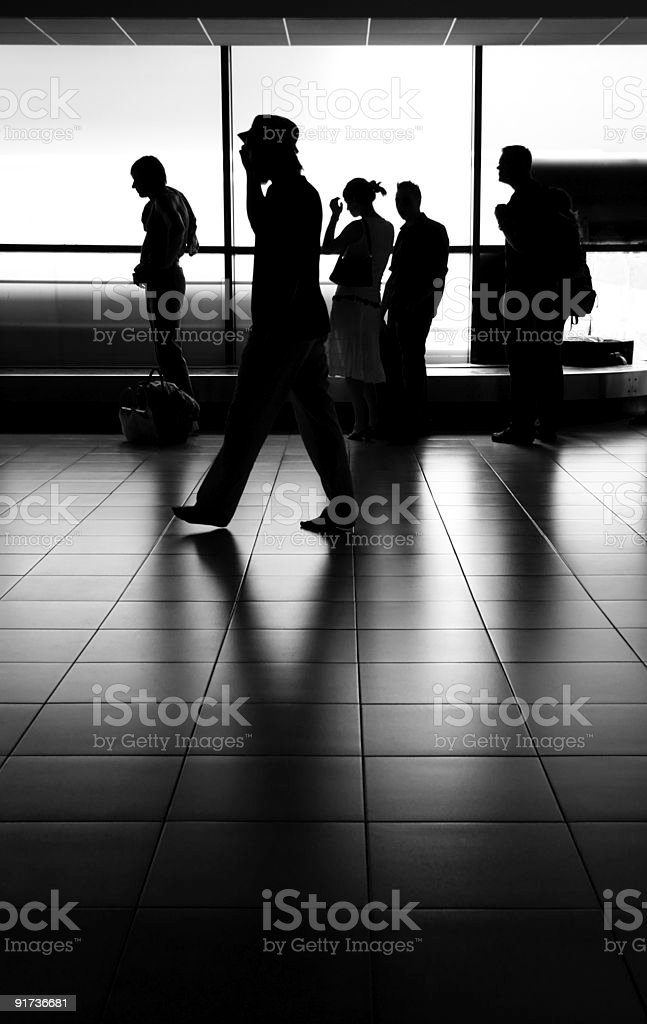 silhouettes at the airport royalty-free stock photo