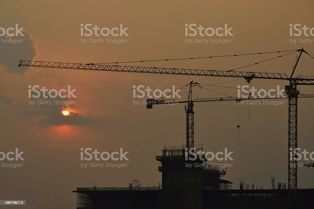 Silhouettes construction cranes royalty-free stock photo