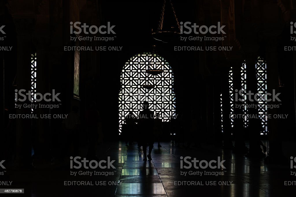 Silhouettes inside the Mosque Cathedral of Cordoba stock photo