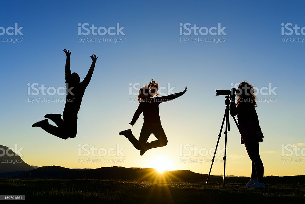 silhouettes jumping stock photo