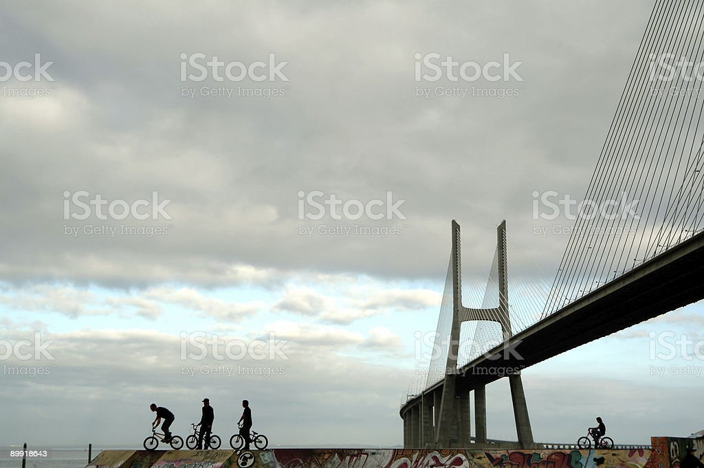 Silhouettes of active teens, urban extreme sports on park royalty-free stock photo