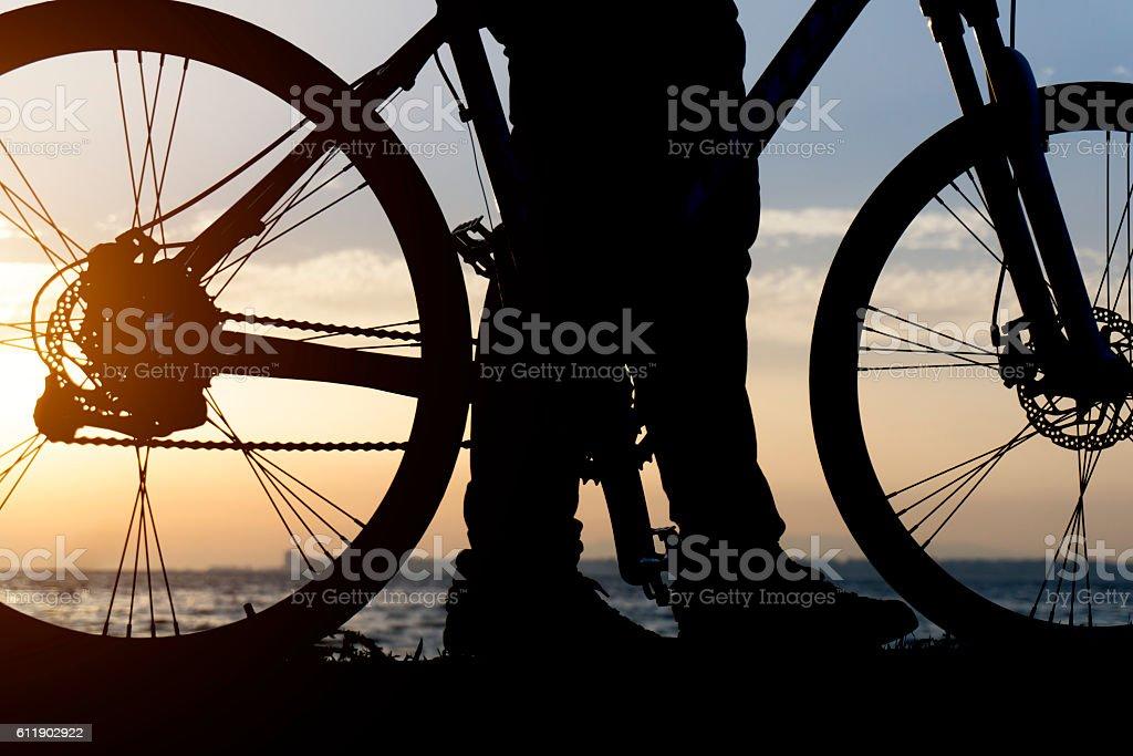 Silhouettes Of Biker stock photo