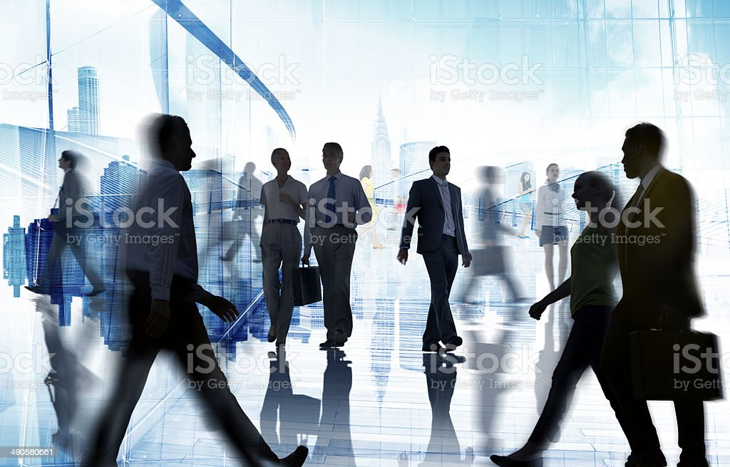 Silhouettes of Business and Casual People Walking stock photo