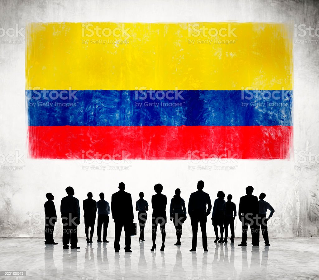 Silhouettes of Business People and a Flag of Colombia stock photo