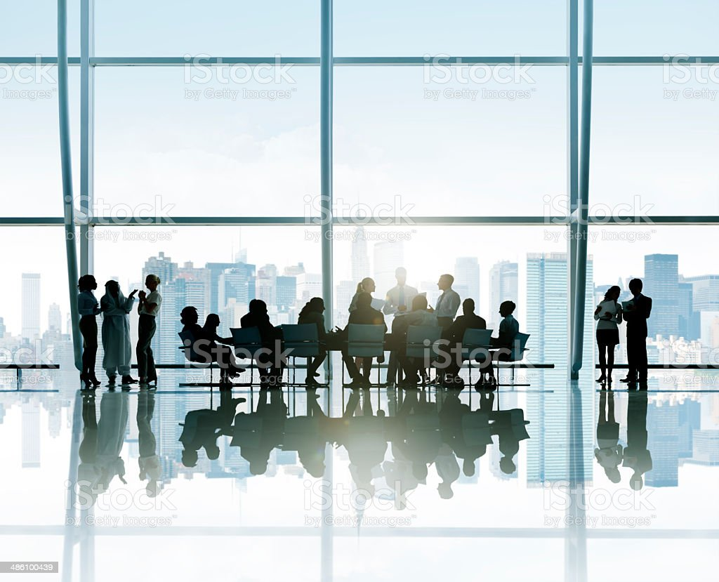 Silhouettes Of Business People Around The Conference Table With stock photo