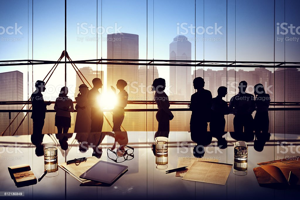Silhouettes of Business People Brainstorming Inside the Office stock photo