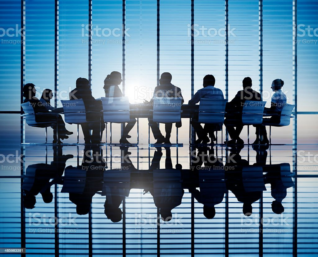 Silhouettes Of Business People In A Conference Room stock photo