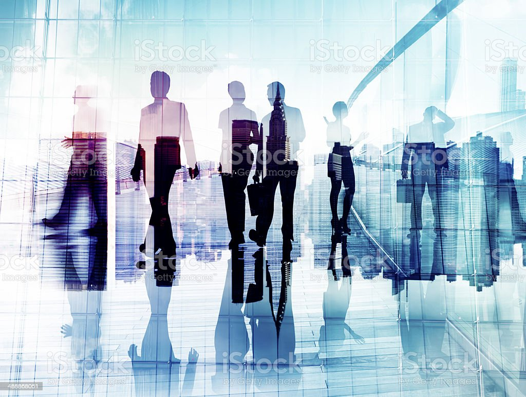 Silhouettes of Business People in Blurred Motion Walking royalty-free stock photo