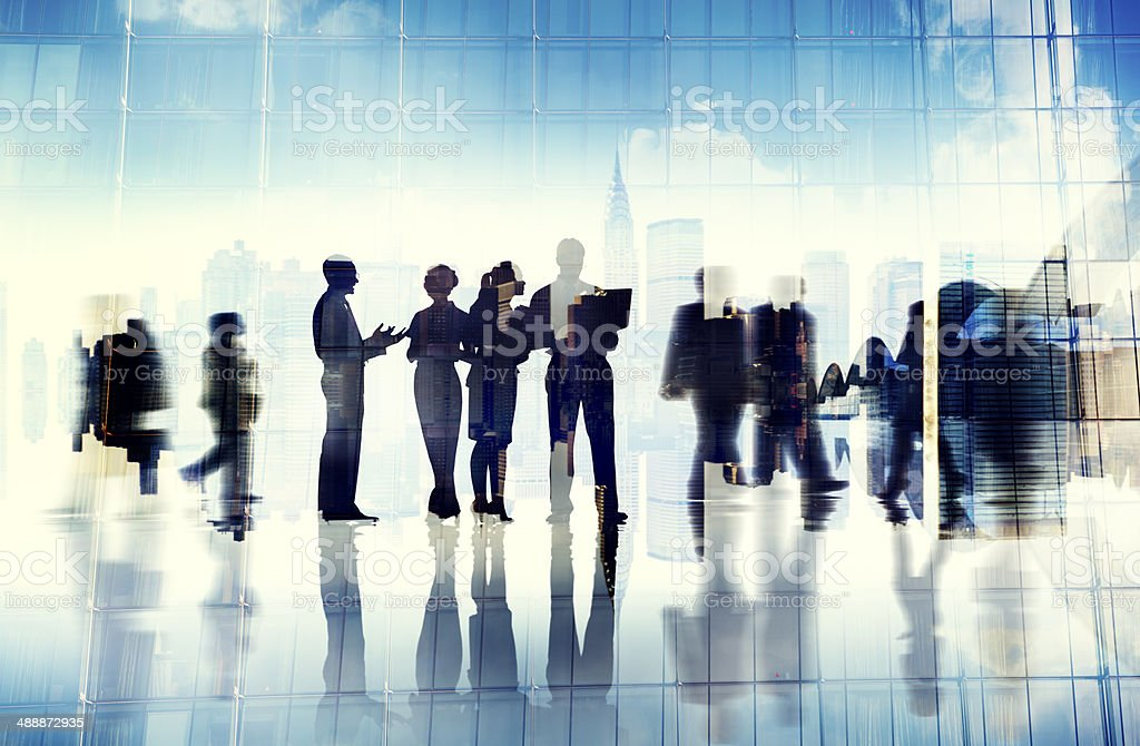 Silhouettes of Business People Inside the Office stock photo
