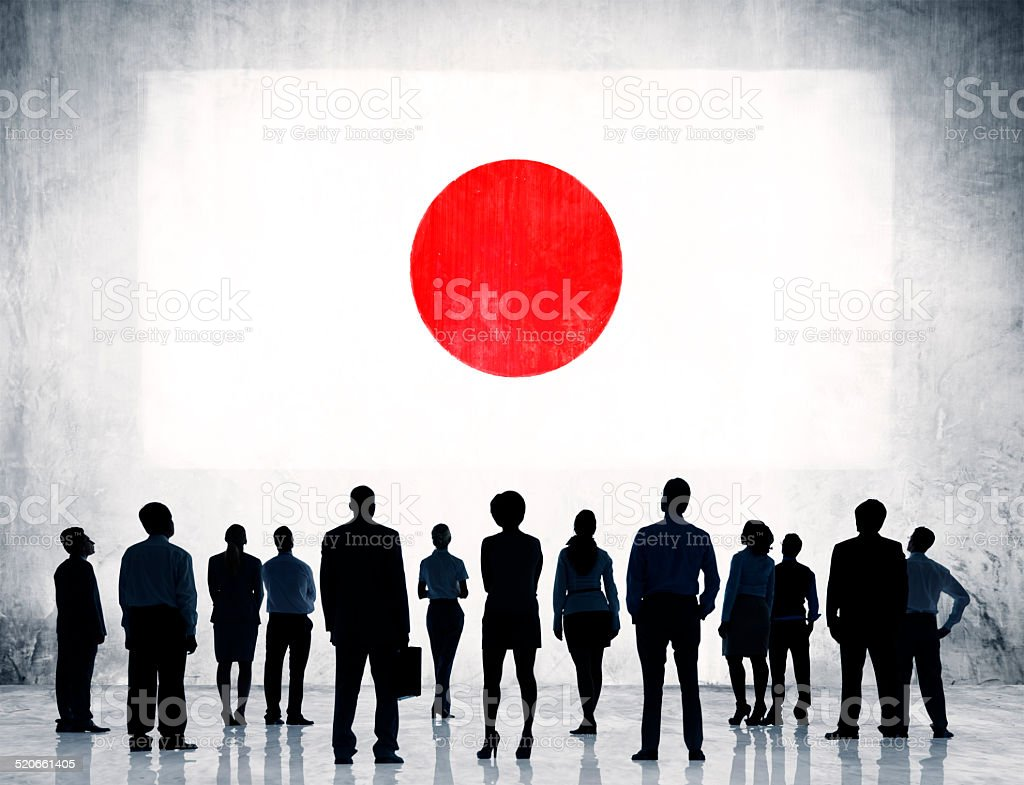 Silhouettes of Business People Looking at the Flag of Japan stock photo
