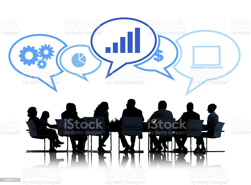 Silhouettes of Business People Meeting with Business Symbols royalty-free stock photo