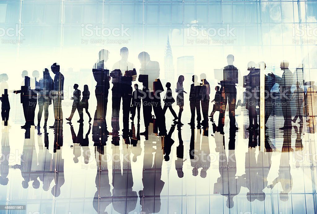 Silhouettes of Business People Working in an Office stock photo