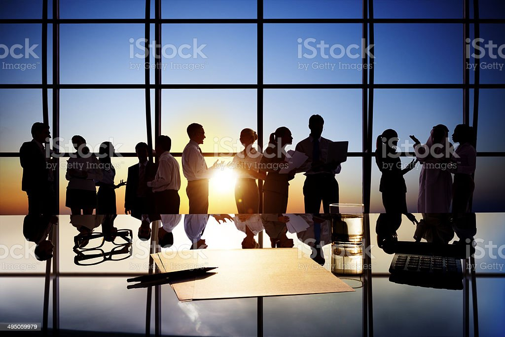 Silhouettes of Business People Working in Board Room stock photo