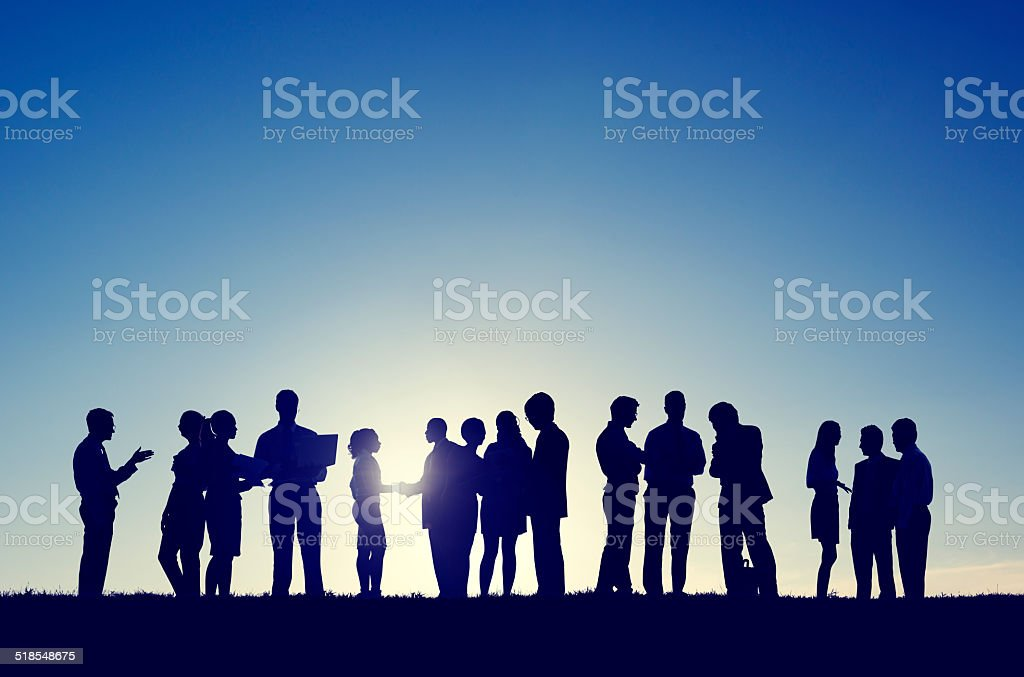 Silhouettes of Business People Working Outdoors stock photo