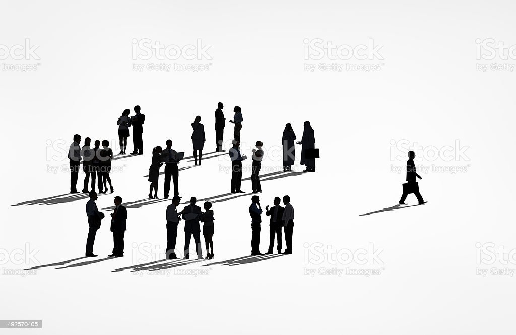 Silhouettes Of Businessman Walking Away From The Group stock photo