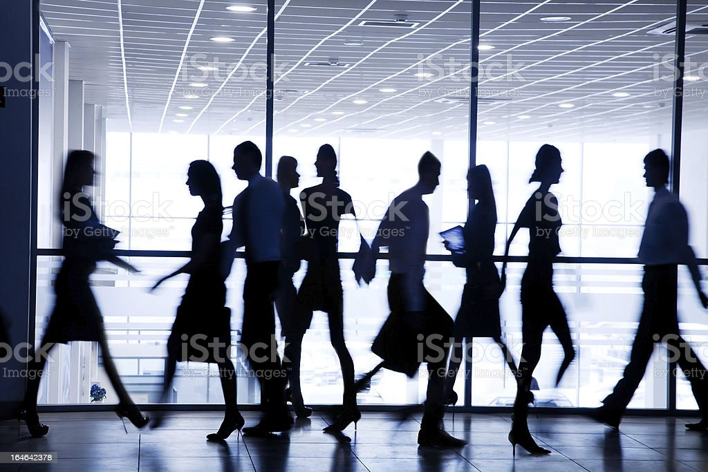 Silhouettes of busy businesspeople royalty-free stock photo
