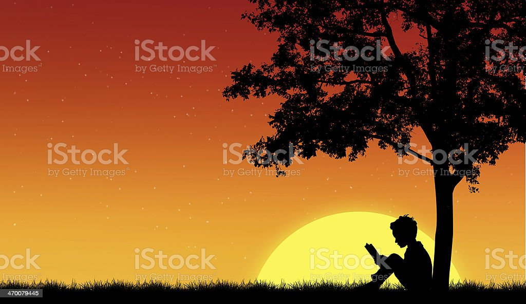 Silhouettes of children read book under tree stock photo