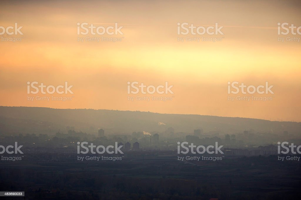 Silhouettes of city during sunset royalty-free stock photo