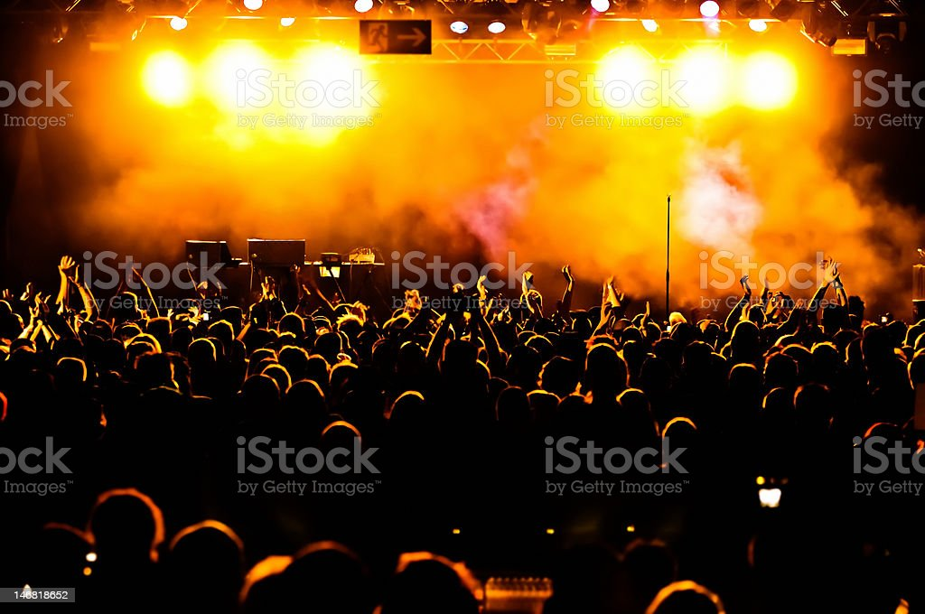 Silhouettes of concert crowd royalty-free stock photo